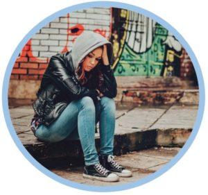 sad-girl-sitting-on-kerb